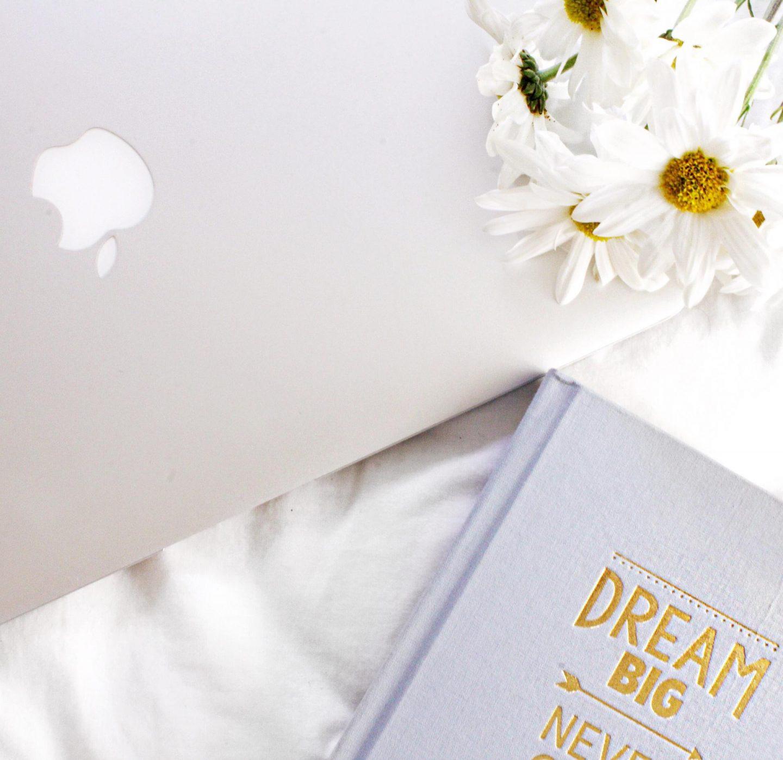 Laptop, notebook & flowers